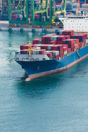 Port Cargo Container Singapore transportation from ship, logistic import export concept