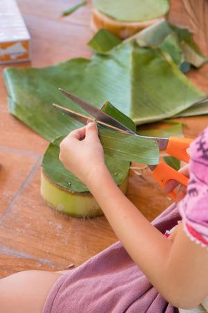 Hands Children make krathong form nature object for Loy Krathong festival in november Imagens