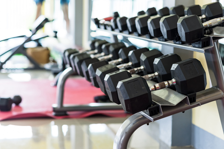 exercise weights in fitness gym, focus on exercise weights