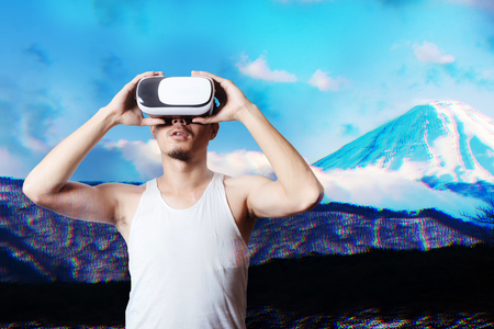 Young Man Using Virtual Reality Glasses See a Simulation image 3D beautiful landscape view