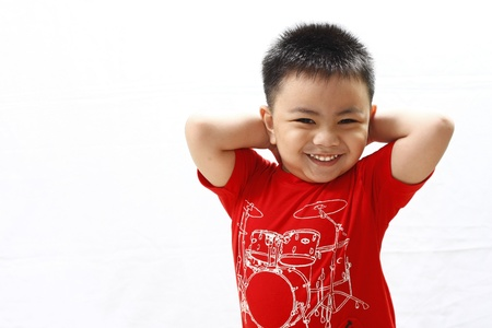 Little Boy Smiling and Holding His Head photo