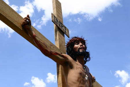 Cainta, Rizal, Philippines. March 29, 2013. An actor playing the role of Jesus in a re-enactment of Christ's crucifixion and death. A tradition in the Philippines called
