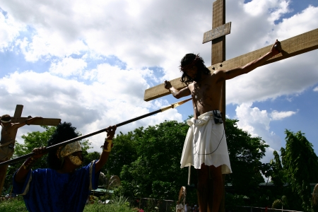 reenact: Cainta, Rizal, Philippines. March 29, 2013. Actors re-enact Christs crucifixion and death. A tradition in the Philippines called Senakulo is held yearly every Holy Week.