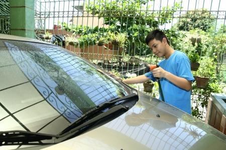 Kid Washing A Car photo