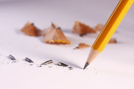 A photo of a pencil with broken leads and shavings  photo