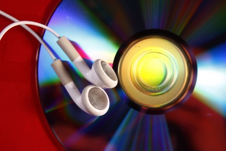 ear buds: A photo of ear buds and a cd  Stock Photo