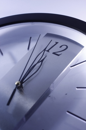 12 o clock: A photo of a clock with its hands pointing towards 12 o clock
