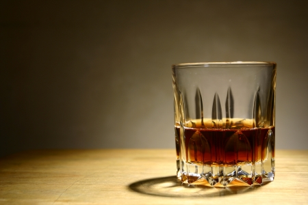 rhum: Alcoholic Drink in a Glass  A photo of an alcoholic drink or liquor in a glass and on a table