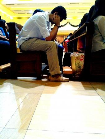 catholic mass: Man sleeping during a catholic mass