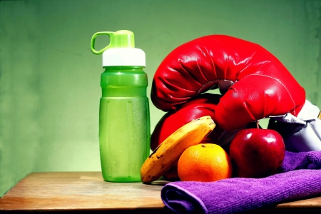 boxing tape: Water fruits banana orange apple towel and boxing gloves Stock Photo
