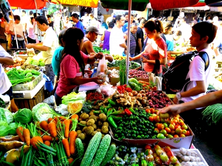Vegetable vendor in a market in cainta rizal philippines asia Stock Photo
