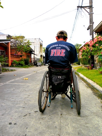 polio: Disabled man on a wheelchair