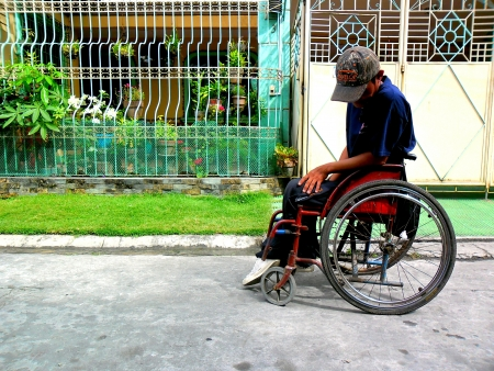 incapacitated: Disabled man on a wheelchair
