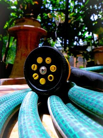pocket: Garden hose Stock Photo