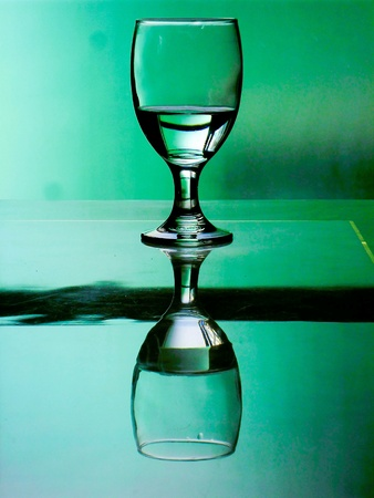 aqua: Water in a water goblet on a reflective table
