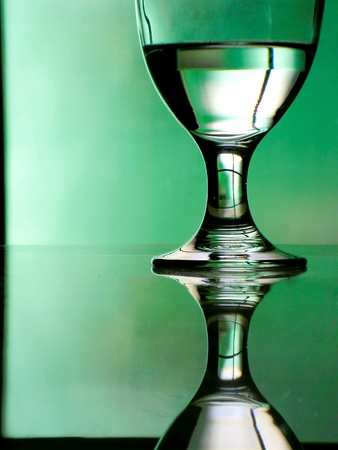 reflective: Water in a water goblet on a reflective table