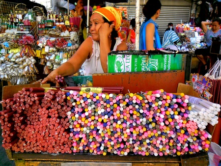 wax sell: Asian street vendor selling colorful candles outside of quiapo church in manila, philippines in asia
