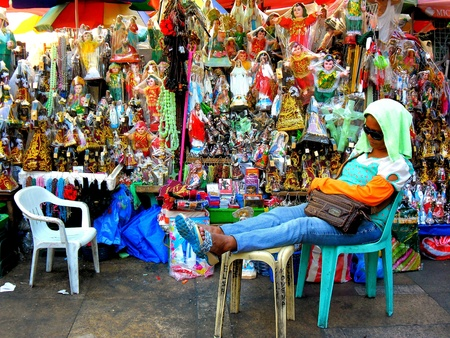 wax sell: Asian street vendor selling catholic relics outside of quiapo church in manila, philippines in asia