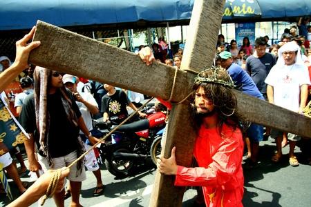 reenact: Catholic devotees reenact the death of jesus christ in cainta, rizal, philippines on good friday