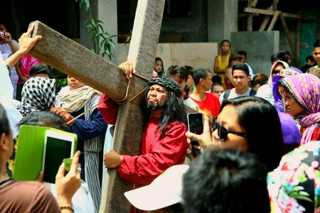 Catholic devotees reenact the death of jesus christ in cainta, rizal, philippines on good friday