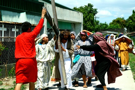 reenact: Catholic devotees reenact the death of jesus christ in cainta, rizal, philippines on good friday