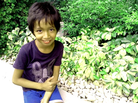 pocket: Asian girl sitting by a plant box or pocket garden and smiling