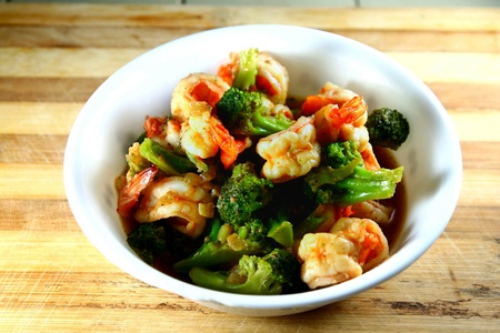 brocolli: Bowl of cooked brocolli and shrimp