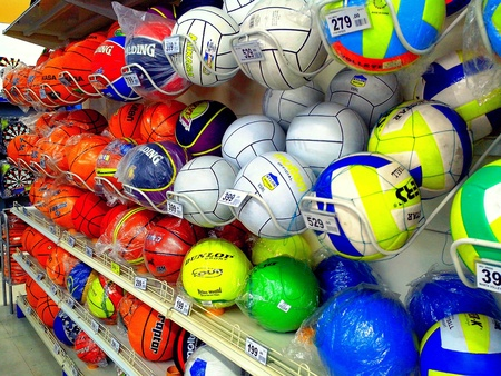basketballs: Basketballs and volleyballs sold in a store