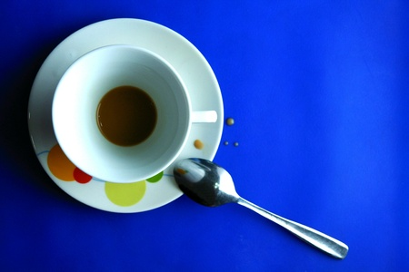 silver: Finished coffee in a cup and saucer with teaspoon
