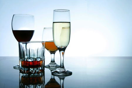 Different types of alcoholic drinks in glasses and goblets