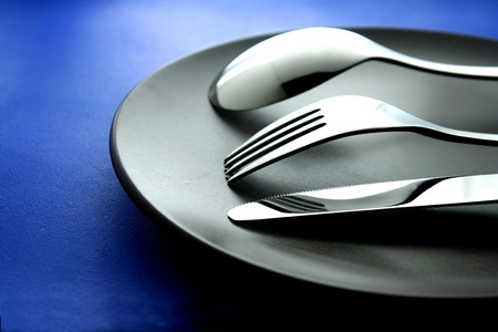 silver: Spoon, Fork, knife and ceramic dinner plate