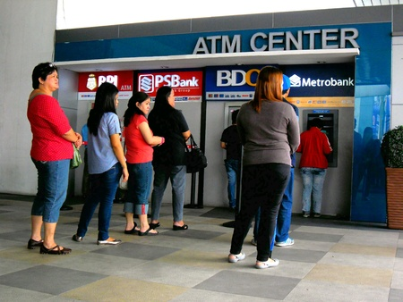 People lining up at atm's in the philippines