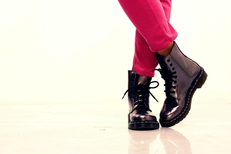 pants: Pink long pants and shiny leather boots on feet and legs