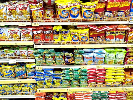 Different chips and junkfood in a supermarket