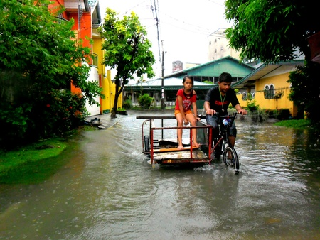 mario: Cainta, rizal, philippines. Flood waters caused by typhoon mario, fung wong, on september 19, 2014 Stock Photo