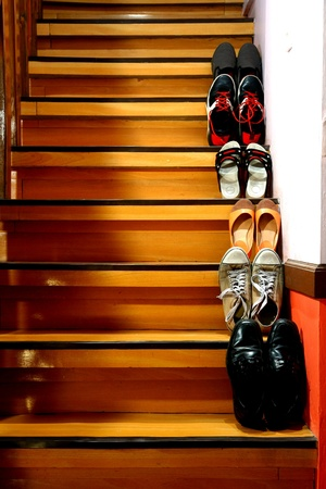 Different shoes on a staircase