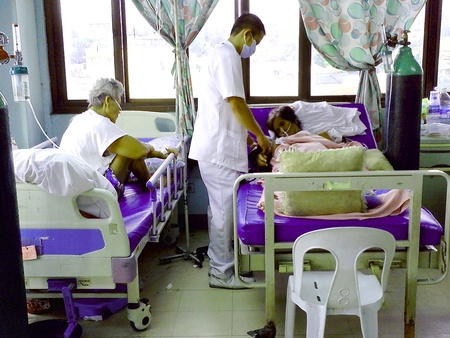 care giver: A nurse attending to a patient inside a hospital in mandaluyong city, philippines, asia