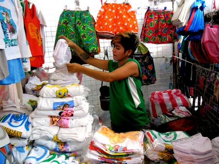 clothes: Vendor selling clothes in a market in taytay rizal philippines
