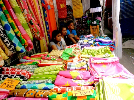 pants: Vendor selling curtains in a market in taytay rizal philippines Stock Photo