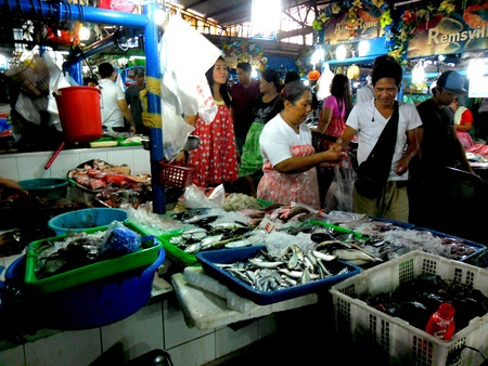city fish market: Wet market vendors selling fish and seafood in cubao, quezon city, philippines Stock Photo