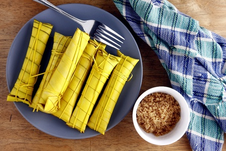 Filipino delicacy food called suman or sticky sweet rice Stok Fotoğraf