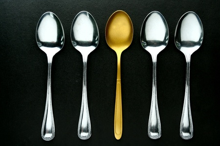 gold: A single Golden spoon among silver spoons