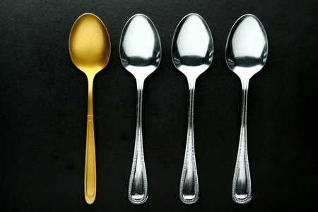 shiny metal: A single Golden spoon among silver spoons