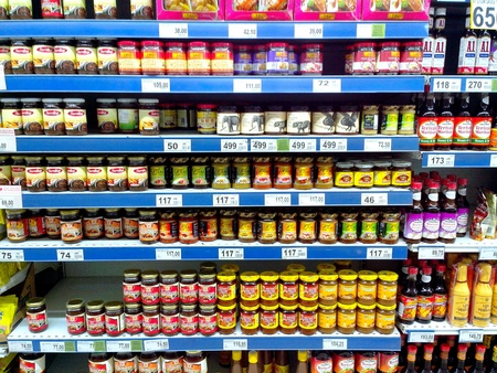 Bottled condiments and food flavoring products sold in a grocery store