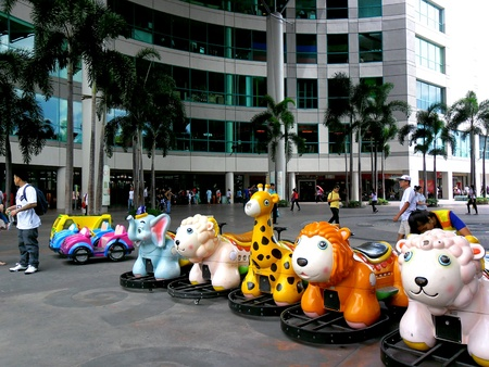 kiddie: Kiddie rides in market market in bonifacio global city in taguig city, philippines Stock Photo