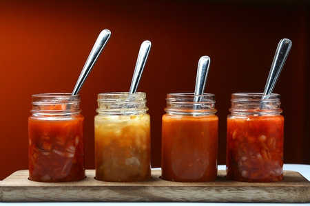 spicy: Photo of different Mexican food dips and sauces in bottles Stock Photo