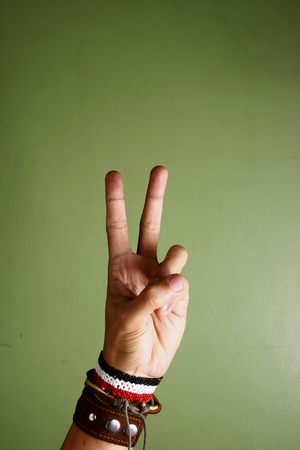 Photo of a hand making a peace sign Stock Photo