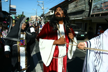 scourge: Cainta, Rizal, Philippines - April 3, 2015 - Actors and Characters in the reenactment of the Passion of Christ. Held on Good Friday as part of celebration of the Holy Week.