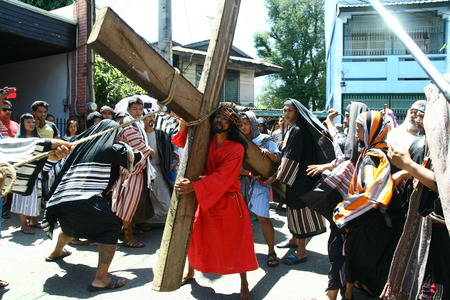 penitence: Cainta, Rizal, Philippines - April 3, 2015 - Penitents reenacting the Passion of Christ. Held on Good Friday as part of celebration of the Holy Week. Editorial