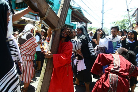 scourging: Cainta, Rizal, Philippines - April 3, 2015 - Penitents reenacting the Passion of Christ. Held on Good Friday as part of celebration of the Holy Week. Editorial
